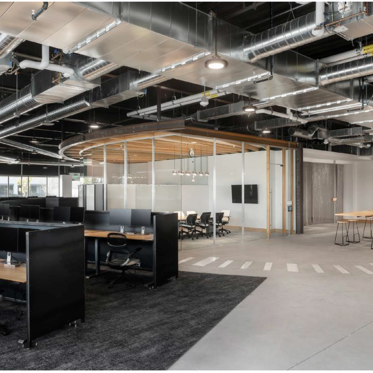 East conference room of glass, radiused steel, wood, and acoustical foam