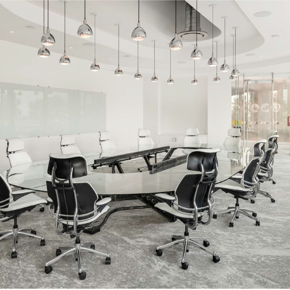 Lobby Conference room with custom Built Chassis frame to mirror the firms concentration in the automotive sector