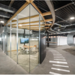 Oblique view of Conference room made of glass, radiused steel, wood and acoustical foam