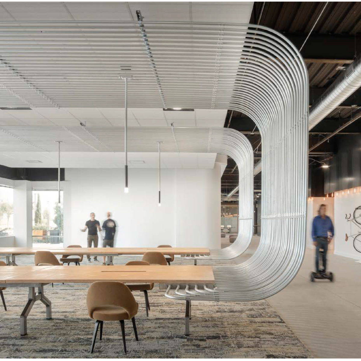 """Seating area wrapped in an architectural """"Fan Coil"""""""